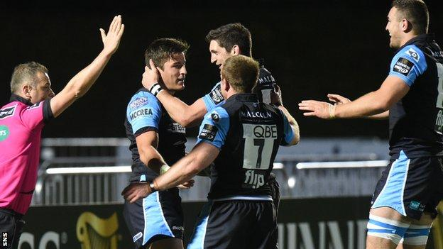DTH Van Der Merwe (second left) celebrates his try for Glasgow Warriors