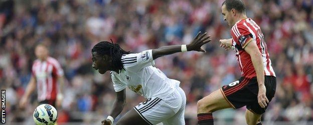 Swansea striker Bafetimbi Gomis gets away from Sunderland defender John O'Shea