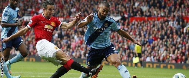 Manchester United striker Robin Van Persie scores against West Ham