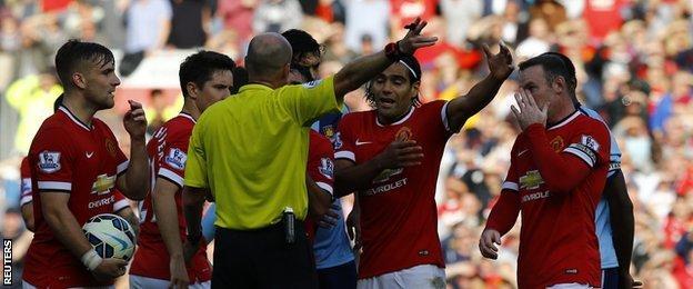 Manchester United striker Wayne Rooney (right) is sent off against West Ham