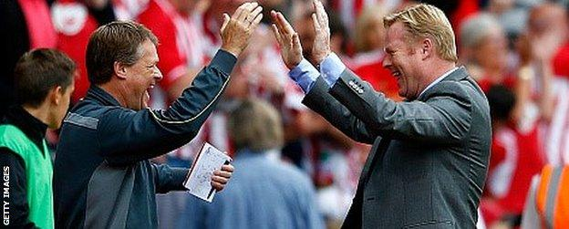 Manager Ronald Koeman (R) of Southampton celebrates their victory with assitant manager Erwin Koeman