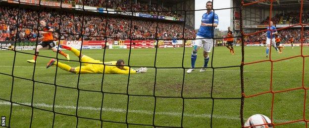 Chris Erskine slots the ball past Alan Mannus for the opening goal