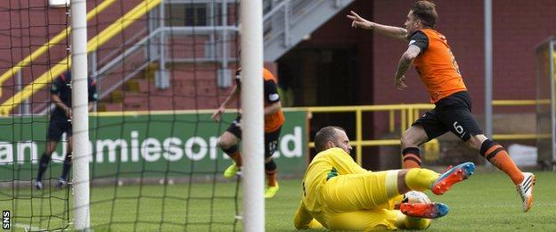 Paul Paton leaves St Johnstone goalkeeper Alan Mannus in despair