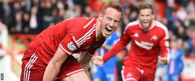 Adam Rooney celebrates after equalising for Aberdeen