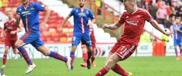 Jonny Hayes slots in the winner for Aberdeen