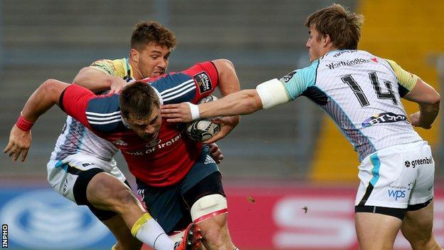 Ospreys try-scorer Jeff Hassler and team-mate Rhys Webb attempt to halt Munster's CJ Stander
