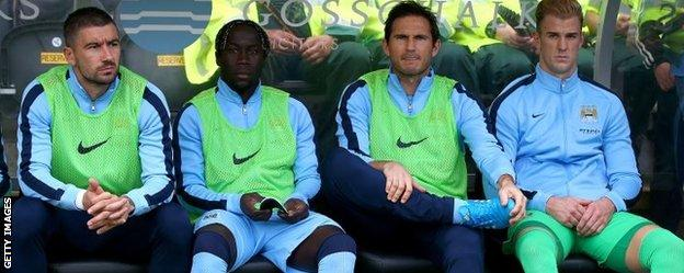 Joe Hart sits with the other Manchester City substitutes