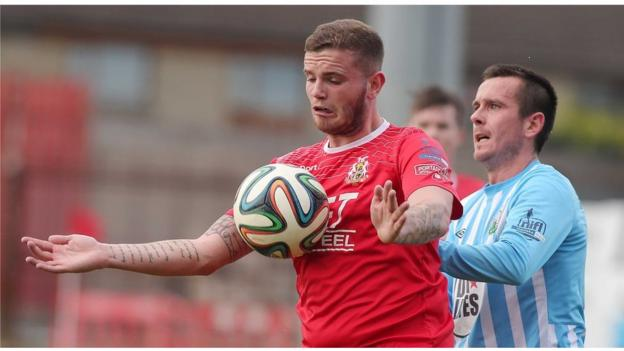 Portadown striker Darren Murray holds the ball up as Mark Hughes challenges for Warrenpoint Town