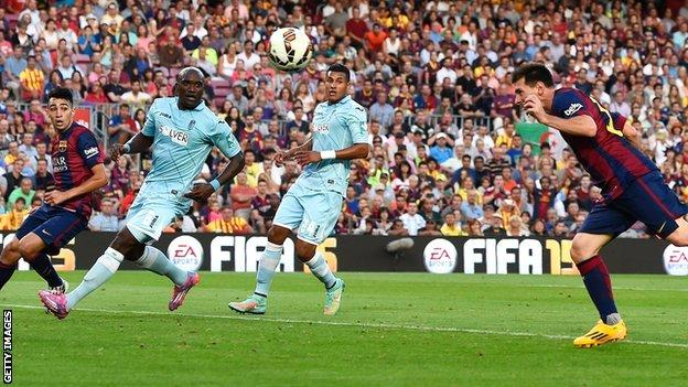 Barcelona's Lionel Messi heads 400th career goal