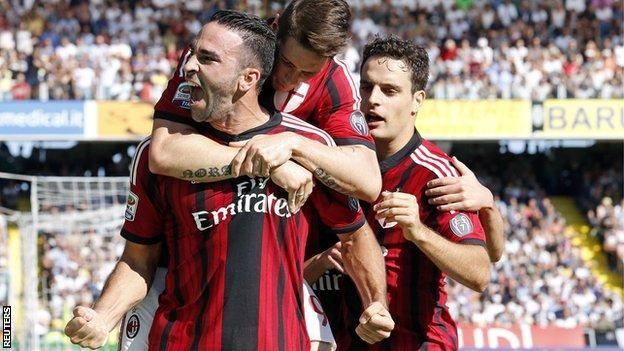 AC Milan celebrate Adil Rami's equaliser at Cesena