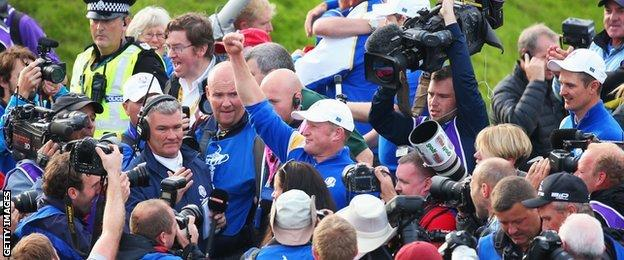 Jamie Donaldson celebrates on the 15th hole after Europe won the Ryder Cup with Donaldson defeating Keegan Bradley