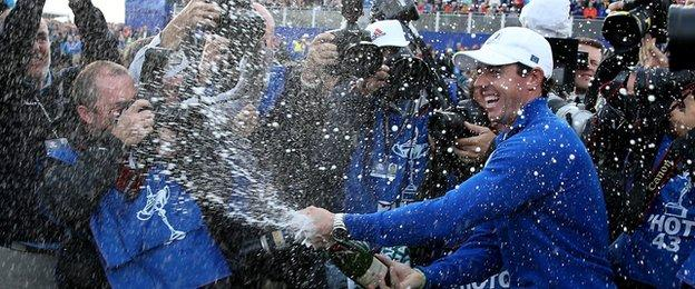 Rory McIlroy celebrates Europe winning the Ryder Cup as he sprays champagne after the Singles Matches