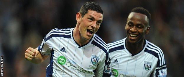West Brom midfielder Graham Dorras celebrates scoring against Burnley