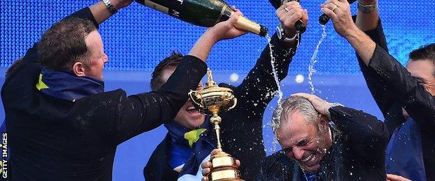 Paul McGinley soaked in champagne