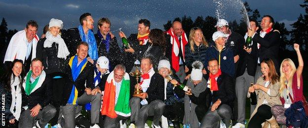 The European team celebrate their victory together with their partners