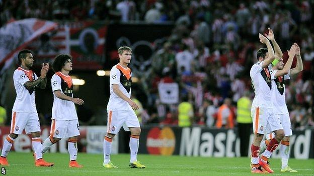 Shakhtar Donetsk players applaud their fans after the 0-0 Champions League match against Athletic Bilbao on 17 September