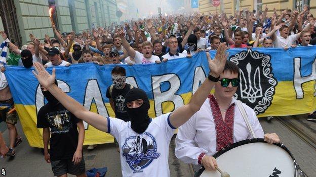 Ukrainian fans of FC Dynamo Kiev, FC Karpaty Lviv and FC Shakhtar Donetsk shout slogans during the 'March of Unity' in the western Ukrainian city of Lviv on July 22, 2014.