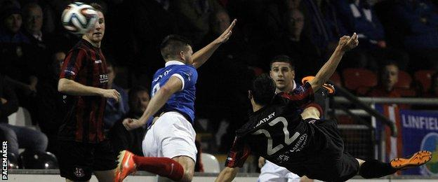 Paul Heatley fires Crusaders into the lead against Linfield