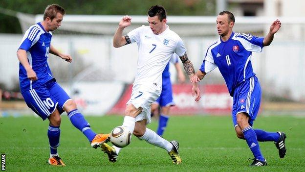 England's Lee Gale (Peel FC) is tackled by Slovakia's Rudolf Bilas