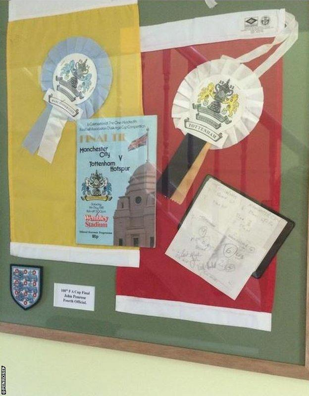 A signed programme, plus flags and referee's notebook, from the 100th FA Cup Final in 1981