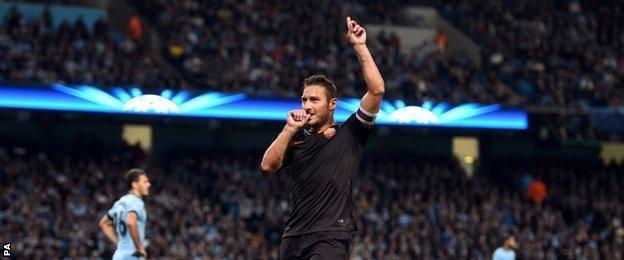 Francesco Totti celebrates his equaliser against Manchester City