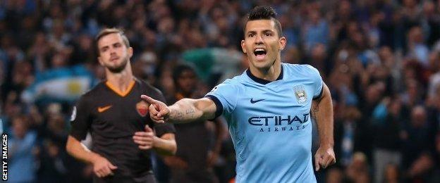 Sergio Aguero celebrates after putting Manchester City ahead from the penalty spot
