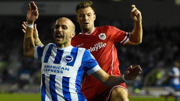 Bruno Salter of Brighton is fouled by Anthony Pilkington of Cardiff
