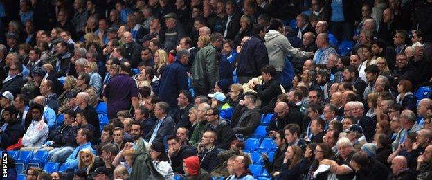 Manchester City fans leave early during their side's draw with Roma