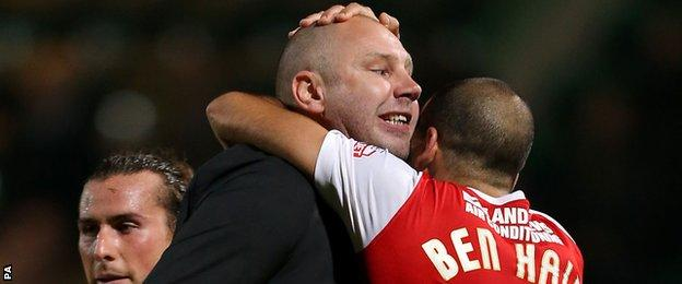 Charlton manager Bob Peeters and Tal Ben Haim embrace after victory at Norwich