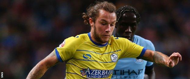 Stevie May in action for Sheffield Wednesday against Manchester City