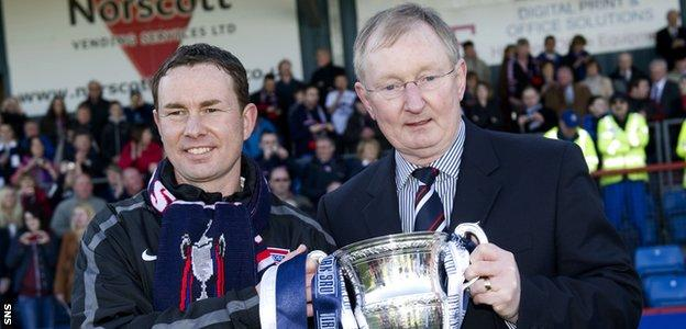 Derek Adams and his director of football father, George, with the Division One trophy