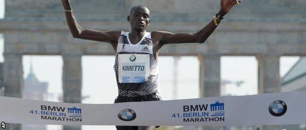 Kimetto crosses the finish line in a new men's record time over the marathon distance