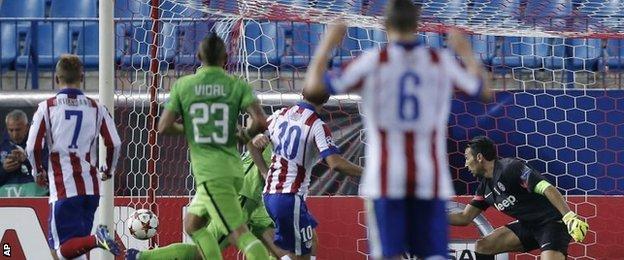 Arda Turan scores for Atletico Madrid
