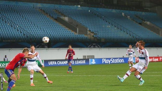 Mario Gotze shoots at goal for Bayern in front of an empty stadium