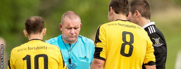 Referee Robert Baxter was unable to continue after being struck by the ball as Oban faced Fort William.