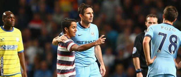 Frank Lampard is snapped in a selfie by a pitch invader during his side's 7-0 win over Sheffield Wednesday