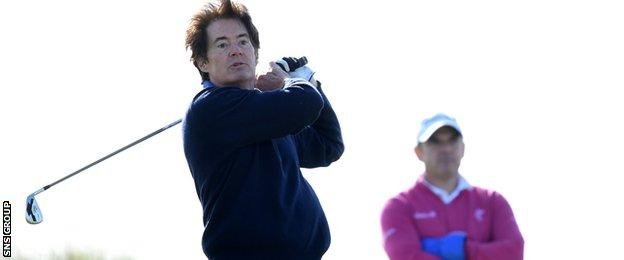 Paul McGinley looks on as Kyle MacLachlan plays a shot