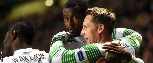 Kris Commons is congratulated on his early goal