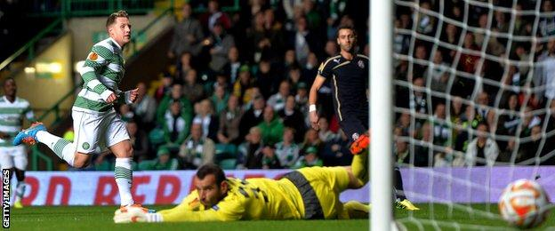 Kris Commons looks on as his early shot finds the corner of the net