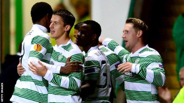 Celtic celebrate an early goal from Kris Commons (right)