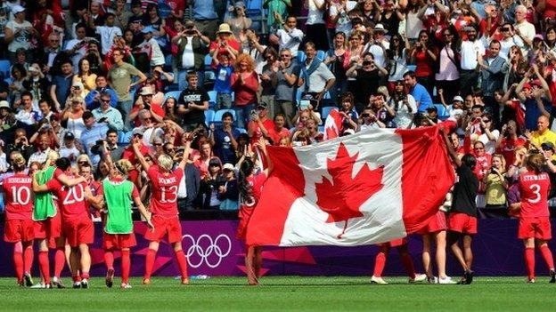 Canada's players celebrate after winning the bronze medal match at the London 2012 Olympic Games