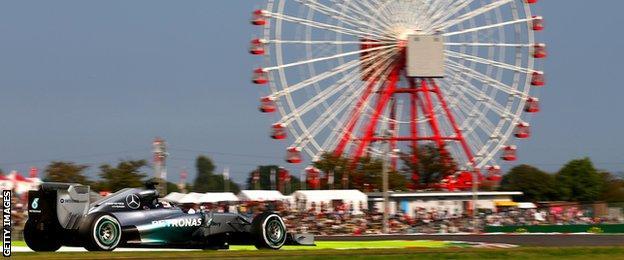 Lewis Hamilton drives past the iconic ferris wheel at Suzuka.