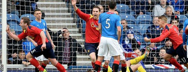 Ciaran Donnelly (left) celebrates after giving Albion Rovers the lead against Rangers at Ibrox in last term's Scottish Cup