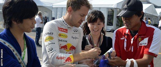 Sebastian Vettel signs autographs for Formula 1 fans in Japan