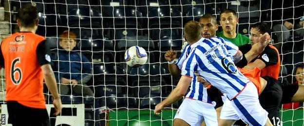 Mark Connolly heads Kilmarnock's second goal