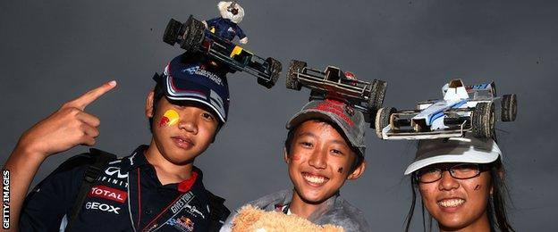 Fans show off their hats at the Japanese Grand Prix
