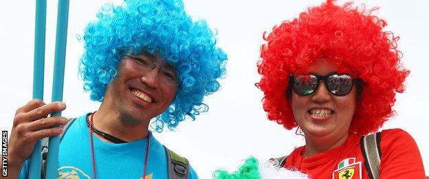 Japanese fans show off their multi-coloured wigs in support of their favourite teams