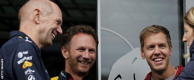 Infiniti Red Bull Racing Team Principal Christian Horner smiles as he speaks with Adrian Newey, the Infiniti Red Bull Racing Chief Technical Officer and Sebastian Vettel.