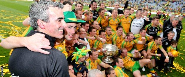 Jim McGuinness celebrates with his Donegal team after their win over Mayo in the All-Ireland football final in September 2012