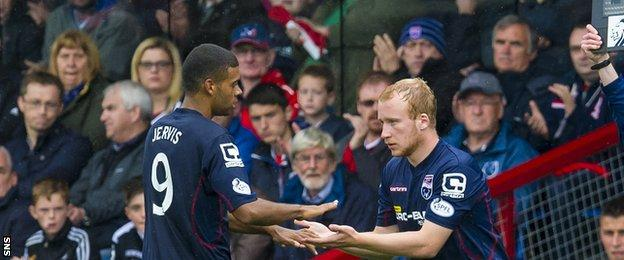 Ross County fans greet their players
